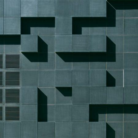 gray-concrete-building-exterior-with-geometric-design-3038740